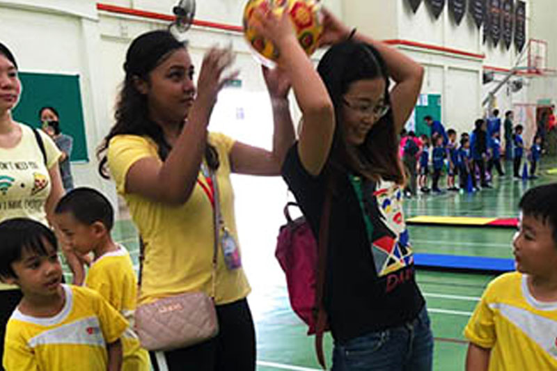 Dressed in their child's house colour, many of the mums and dads took part in the activity stations set out in the badminton hall.